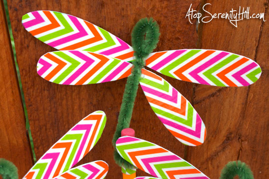 hot glue duck tape wings on pipe cleaner dragonfly