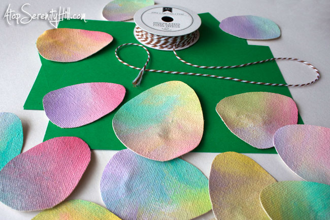 Easy tutorial for a canvas and paper Easter egg garland • AtopSerenityHill.com #easter #garland #holiday