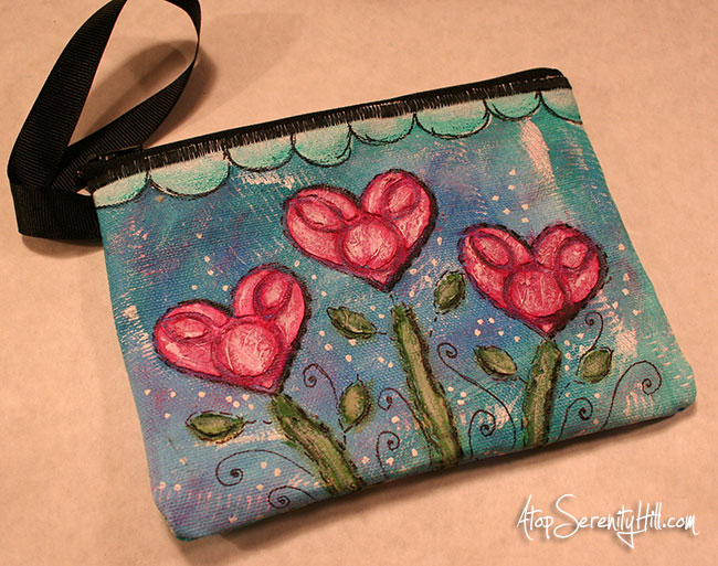 Stenciled canvas pouch or wristlet using decorating paste and acrylic paints • AtopSerenityHill.com #zipperedpouch #stenciling #acrylic