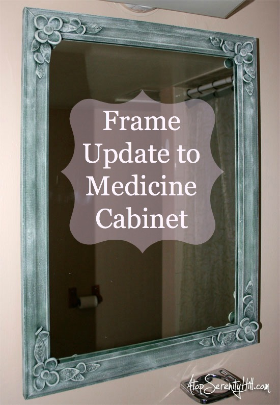 See how I updated an old medicine cabinet with clay flowers and a wooden frame • AtopSerenityHill.com #medicinecabinet #bathroom