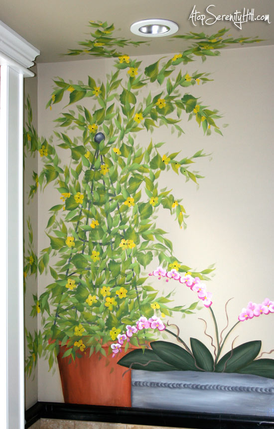 yellowflowersonswroughtirontrellis