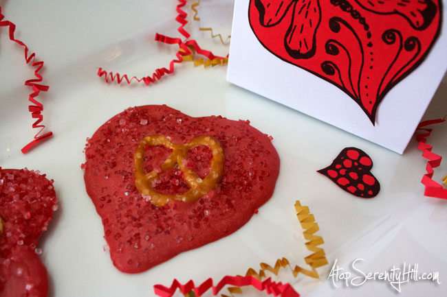 Chocolate hearts w/pretzel center...a sweet and salty Valentine favor! • AtopSerenityHill.com #hearts #desset #chocolate