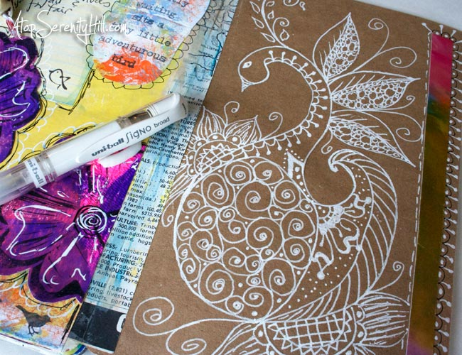One of my must-have art journaling supplies...a White Signo gel pen! • AtopSerenityHill.com